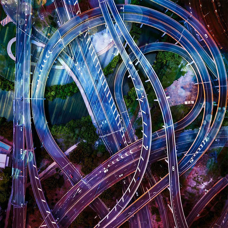 Abstract overlay on top of an aerial photo of a complex highway system