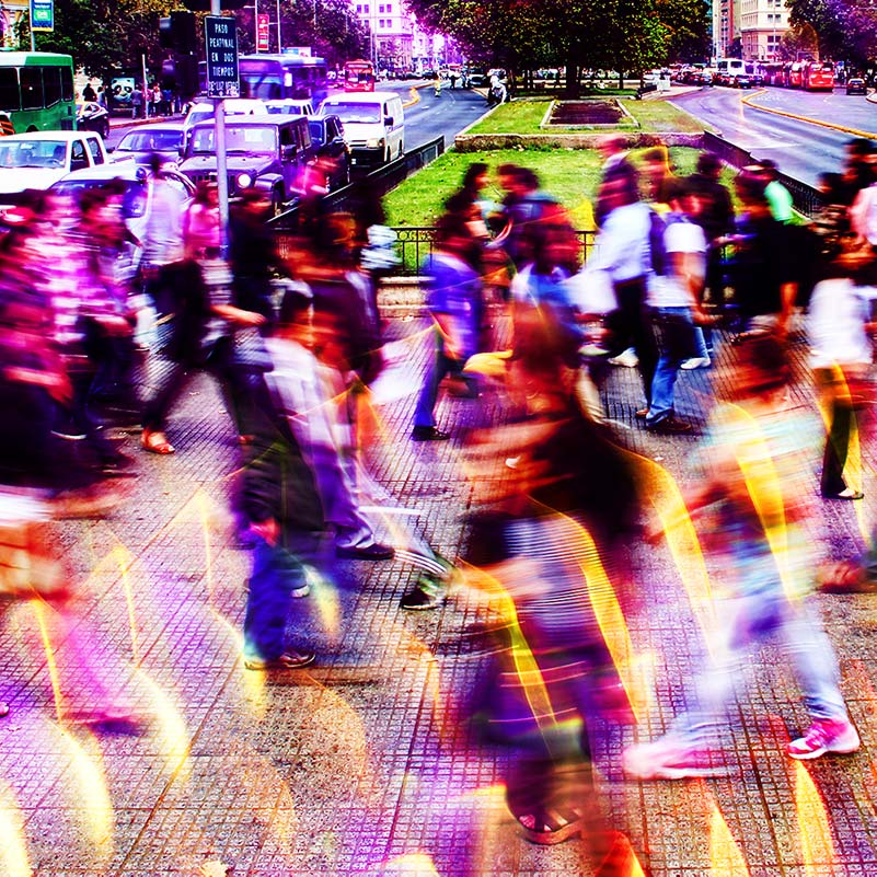 Abstract overlay on photo of people walking fast on a busy street