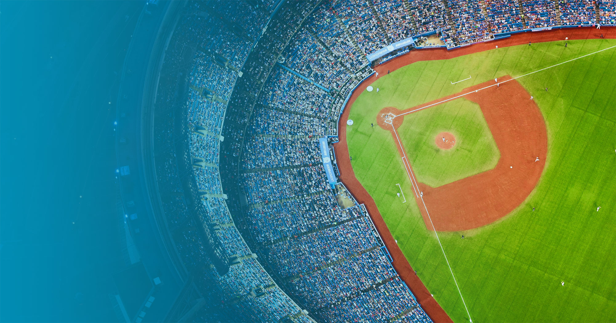 Aerial view of a crowded baseball stadium during a baseball game