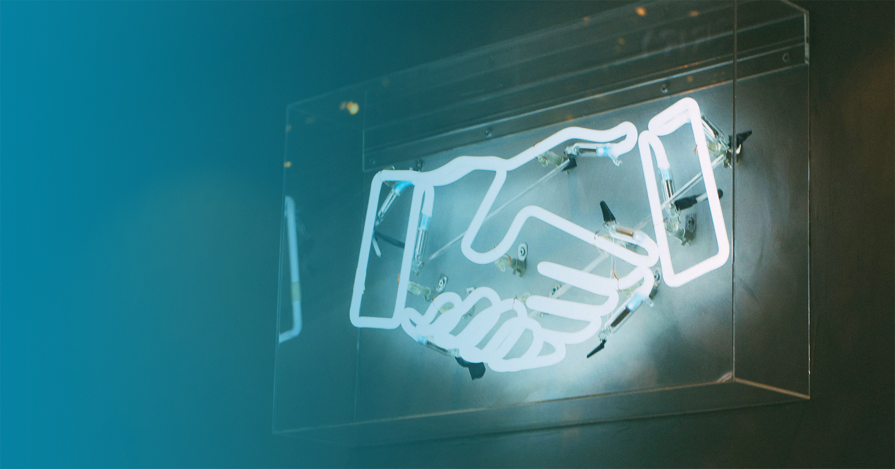 Neon sign of handshake