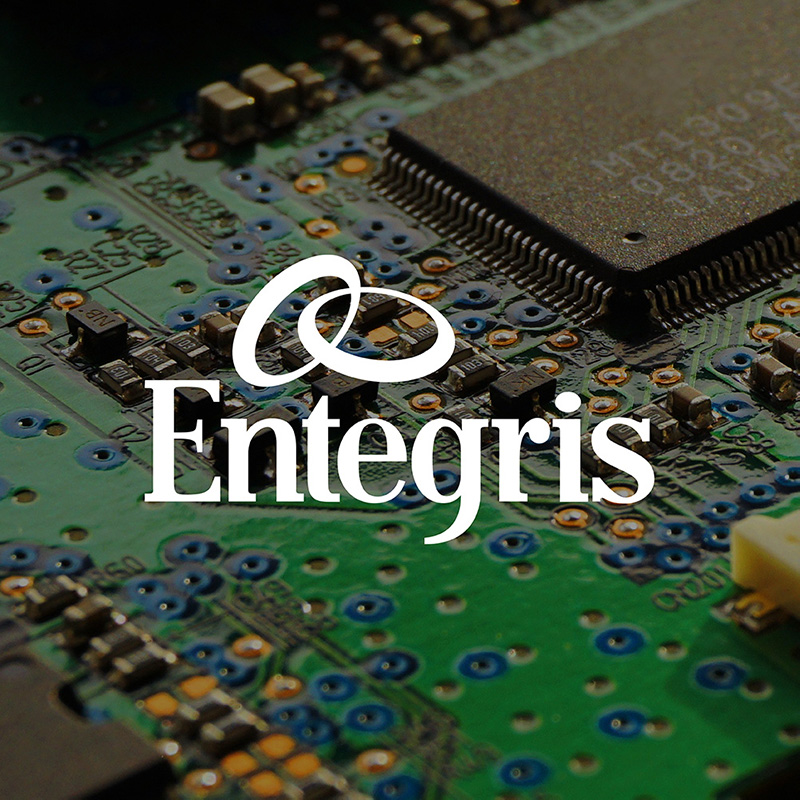 Entegris logo over circuit board photo