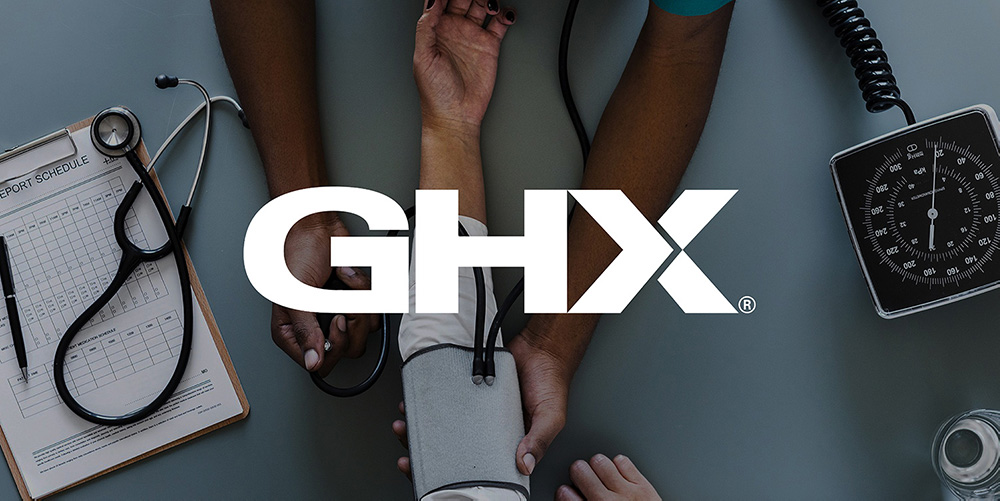 GHX logo over photo of doctor using medical equipment