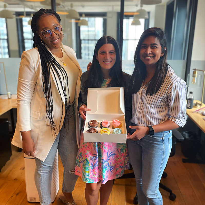 Coworkers celebrating birthday in office