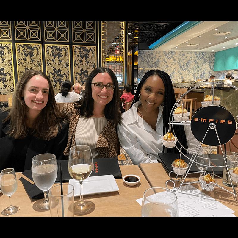 Coworkers enjoying dinner