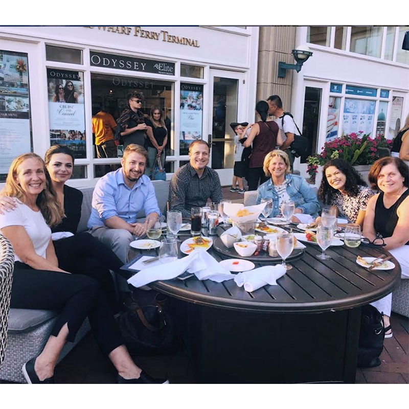 Coworkers eating dinner on patio